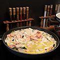 Poêlée de saumon, d'encornets et de courgettes à la crème