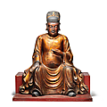 A rare and large <b>gilt</b>-<b>lacquered</b> wood figure of Wenchang, 17th century