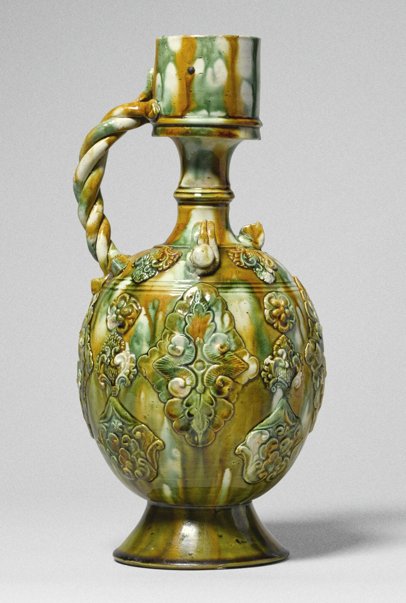 A magnificent sancai-glazed ewer, Tang dynasty