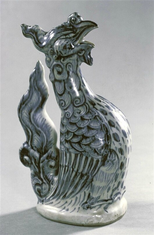 Phoenix-shaped Vessel, Annamese, c. 1500. Clay, cobalt, glaze; height x width x diameter: 11 3/8 x 4 x 6 5/8 in. (28.9 x 10.2 x 16.8 cm). Gift of the Honorable and Mrs. G. Mennen Williams. 73.325. Purchased by donor from Moon Gate, Singapore. Detroit Insti
