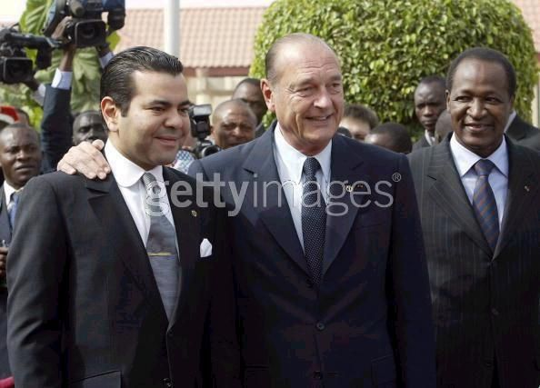 Crown Prince Moulay Rachid poses with French President Jacques Chirac and Burkia Faso President Blaise Compaore 26 November 2004 in Ouagadougou before the opening of the Francophone Summit.