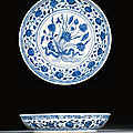 A blue and white '<b>lotus</b> bouquet' dish, Ming Dynasty, 15th century