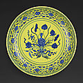 A rare underglaze-blue and yellow-enamelled 'lotus bouquet' charger, mark and period <b>of</b> Yongzheng (1723-1735)