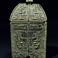 A rare and finely cast bronze ritual wine vessel and cover, <b>fangyi</b>, Late Shang dynasty, 13th-11th century BC