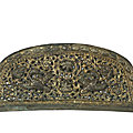 A rare parcel-<b>gilt</b> <b>bronze</b> reticulated 'flying geese' comb top, Tang Dynasty (618-907)