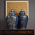 A pair of large gilt-decorated powder blue jars and covers, Kangxi period (1662-1722)