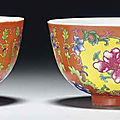 A pair of famille rose <b>coral</b>-ground bowls, Guangxu six-character marks in underglaze blue and of the period (1875-1908)