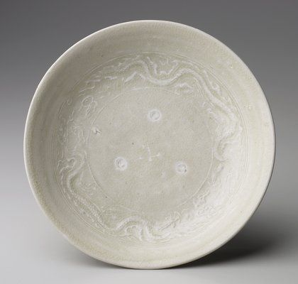 Vietnam, Dish with Molded Dragons, Tran dynasty, High fired stoneware with molded decor under a light blue glaze, H.1-7/16 x Dia.6-1/2 in. Gift of Clifford and Suzanne Roberts. 2000.82.4. The Minneapolis Institute of Arts ©The Minneapolis Institute of Arts