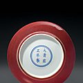 A small <b>copper</b>-<b>red</b>-<b>glazed</b> dish, China, Qing dynasty, Yongzheng six-character mark in underglaze blue within a double circle and