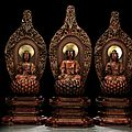 A rare group of three red dry-lacquered and wood figures of Buddha Shakyamuni and a pair of <b>Bodhisattvas</b>, China, 18th century