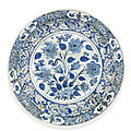A black, blue and white pottery dish, safavid iran, 17th century
