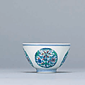 A fine and rare doucai 'Floral' cup, Yongzheng six-character mark in underglaze blue within a double circle and of the period
