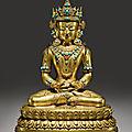 A gilt copper alloy figure of <b>Amitayus</b>, Tibet, 15th-16th Century