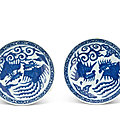 A pair of blue and white 'phoenix' saucer dishes, Marks and period of Wanli (<b>1573</b>-<b>1619</b>)