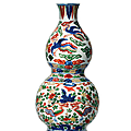 A rare wucai 'phoenix' double-gourd-form wall vase, <b>Wanli</b> <b>six</b>-<b>character</b> <b>mark</b> in underglaze blue within a double rectangle <b>and</b> <b>of</b>