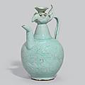 A carvedQingbai-glazed 'Phoenix-head' ewer, Song dynasty (970-1279)