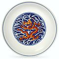 An iron-red-decorated blue and white 'dragon' dish, Qianlong six-character seal mark in underglaze blue and of the period (1736-1795)