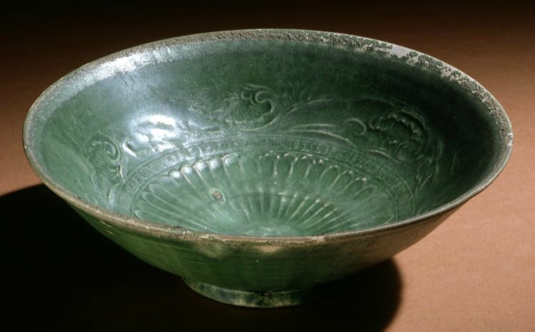 Bowl, 13thC, Vietnam, Thanh Hoa. Made of green moulded, lead glazed stoneware.. Diameter: 17.8 centimetres. Height: 2.3 inches. Donated by Sir Percival David, 2nd Baronet. 1931,0715.3. British Museum © The Trustees of the British Museum.
