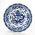 A rare and important imperial blue and white '<b>dragon</b>' <b>dish</b>, Qianlong six-character seal mark and of the period (1736-1795)