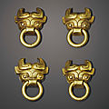 A set of four miniature gold mask-form handles, <b>Eastern</b> <b>Zhou</b> <b>dynasty</b> (770-256 BC)