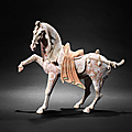 A large <b>painted</b> pottery model of a prancing horse, Tang Dynasty