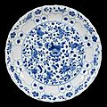 A Chinese blue and white moulded dish, Kangxi mark and period (1662-1722)