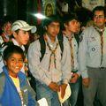 Con la tía Claudia y el dirigente Beto, los scouts participaron a la misa