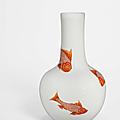 A rare moulded <b>iron</b>-<b>red</b> <b>and</b> <b>gilt</b>-<b>decorated</b> 'fish' vase, tianqiuping, Yongzheng period (1723-1735)