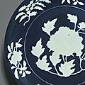 An exceptionally rare <b>and</b> large fine blue <b>and</b> white reserve-decorated 'peony' dish, <b>Xuande</b> <b>mark</b> <b>and</b> <b>period</b> (1426–1435)