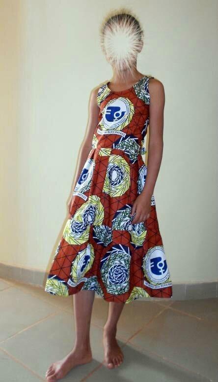 Pagne du 8 mars cousu en robe - SB Afrique Couture