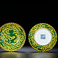 A fine pair of yellow-ground <b>green</b>-<b>enamelled</b> 'dragon' foliate dishes, Qianlong six-character seal marks and of the period