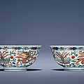 A fine pair offamille verte'Dragon and Pheonix' bowls, Kangxi six-character marks in underglaze blue within double circles and of the period (1662-1722)