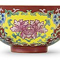 A coral-ground famille rose bowl, <b>Qianlong</b> <b>mark</b> <b>and</b> <b>period</b> (<b>1736</b>-<b>1795</b>)