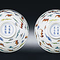 A fine pair of smalldoucai'Hundred <b>bats</b>' <b>bowls</b>, Yongzheng six-character marks and of the period (1723-1735)