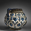 A Kashan moulded cobalt-blue, black and white jug, Central Iran, Early <b>13th</b> <b>century</b>