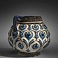 A Kashan moulded cobalt-blue, <b>black</b> <b>and</b> <b>white</b> jug, Central Iran, Early 13th century