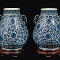 A pair of blue and white double handled vases with floral decoration, china, qing dynasty, 19th century