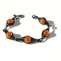 bracelet métal noir perles oranges 3