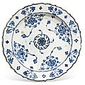 An Iznik blue and white cusped-rim pottery dish, Ottoman Turkey, circa <b>1570</b>-75