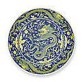 A <b>blue</b>-<b>ground</b> <b>yellow</b>-<b>enamelled</b> 'dragon' dish, Qianlong seal mark and period (1736-1795)