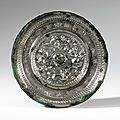 AN INSCRIBED 'MYTHICAL BEASTS' BRONZE MIRROR, SUI DYNASTY