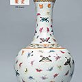 AFamille rose'Butterfly' bottle vase, Xuantong six-character mark in iron red and of the period (1908-1911)