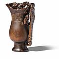 An archaistic rhinoceros horn rhyton cup, 17th-18th century