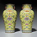 A very rare and superbly enameled pair of yellow-ground famille rose baluster vases, Jiaqing six-character seals mark in iron red and of the period (1796-1820)