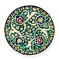 A kubachi rimless pottery dish, probably tabriz, north west iran, 17th century