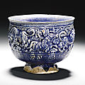 A fine Kashan moulded blue-glazed bowl, Persia, second half <b>12th</b>-<b>early</b> <b>13th</b> <b>century</b>