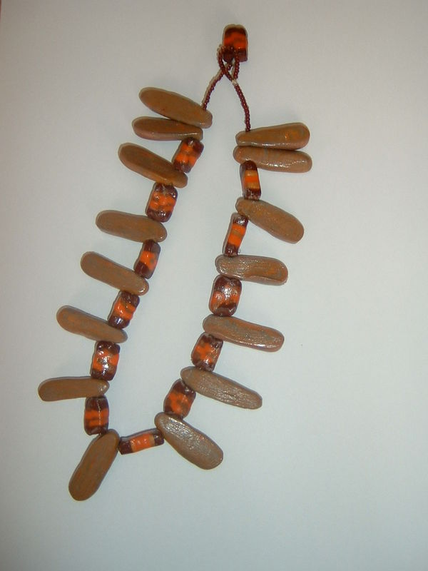 collier bâton maron