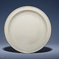 A rare mouldedDing dish, Yuan dynasty (1279-1368)