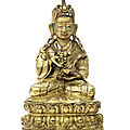 A gilt-copper figure of <b>Padmasambhava</b>, Tibet, 17th-18th century