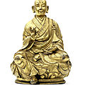 A rare inscribed gilt-copper alloy figure of <b>Arhat</b> Bhadra, Tibet, 17th century